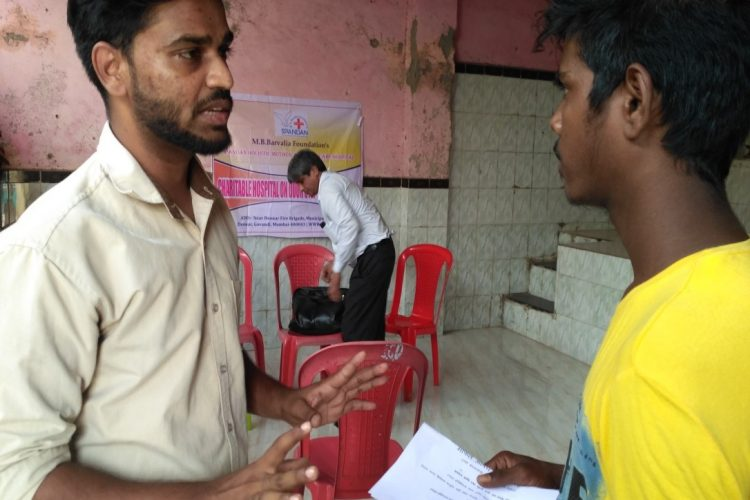 Medical camp-social worker interacting with addict