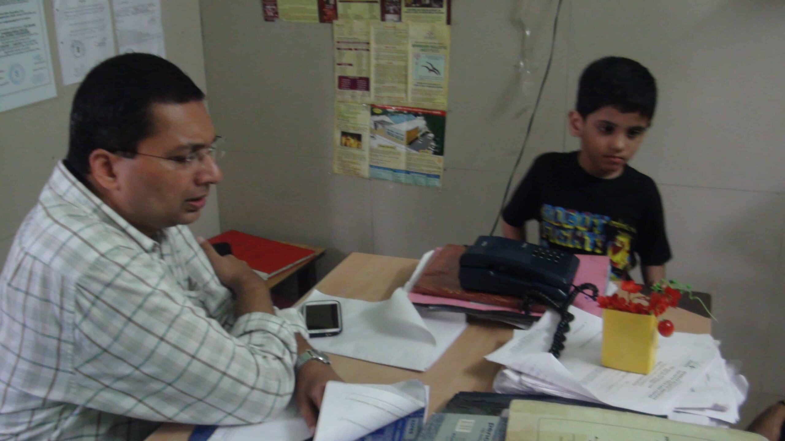 Malay Dave (Psychiatrist) discussing with parents
